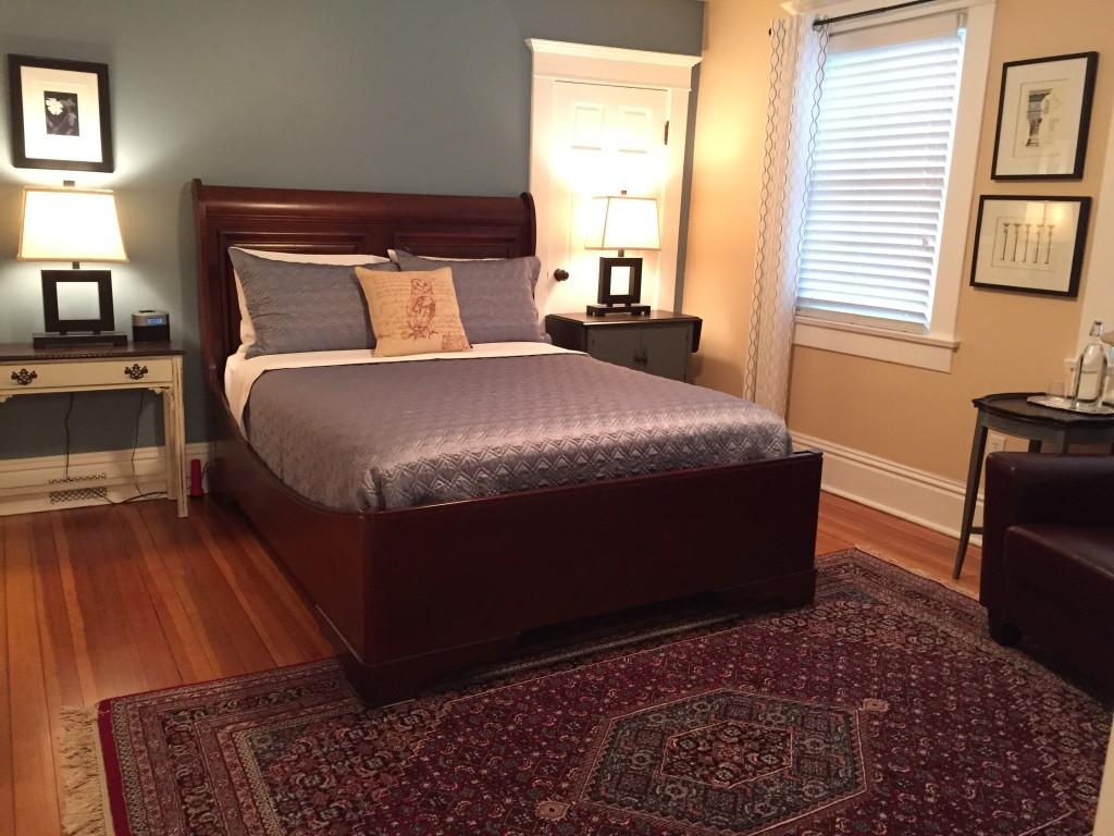 A comfortable sleigh bed compliments the Fireside Suite.