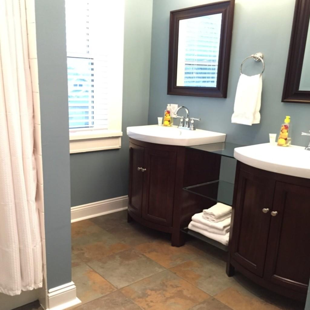 Heated tile floor, custom dual vanities and soaking tub with shower.