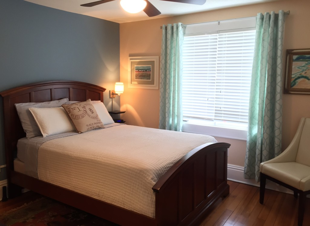 A Cherry wood panel bed compliments the Sunset Suite.